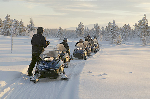 Group of snowmobilers hitting the trails